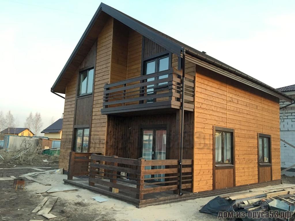 Популярный каркасный дом с балконом